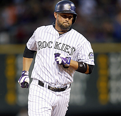 Michael Cuddyer connects for a home run to extend his hitting streak to 25 games in a Rockies win.  (USATSI)