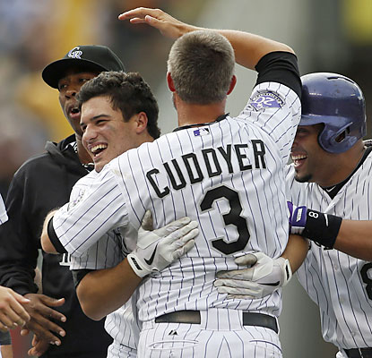 Michael Cuddyer, who extends his hit streak to 26 games, congratulates Nolan Arenado, who delivers the walk-off hit. (USATSI)