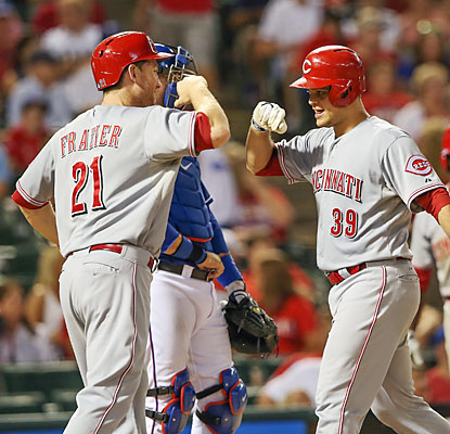 Todd Frazier congratulates Devin Mesoraco, who slams a two-run home run in the 11th inning. (USATSI)