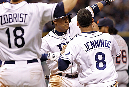 The Rays celebrate their extra-inning, walk-off victory over the first-place Tigers.  (USATSI)