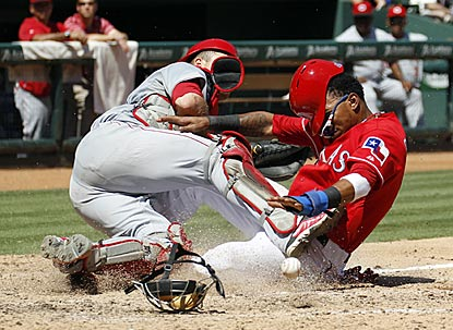 Engel Beltre (right) collides with Cincinnati's Devin Mesoraco while scoring on Elvis Andrus' squeeze bunt in the fifth inning. (USATSI)