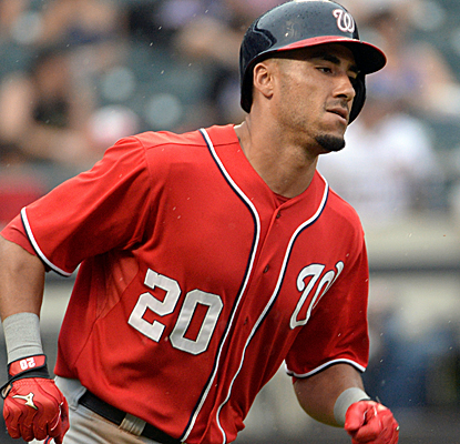 Ian Desmond rounds the bases after a two-run home run, helping the Nats take care of the Mets.   (USATSI)