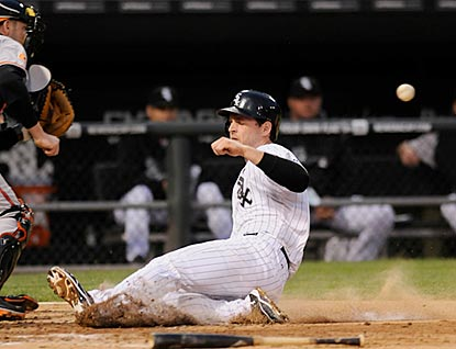 White Sox third baseman Conor Gillaspie scores on Gordon Beckham's single in the fourth inning.  (USATSI)