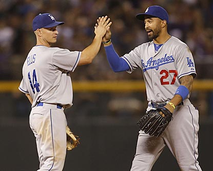 Mark Ellis (left) and Matt Kemp celebrate the Dodgers' seventh consecutive victory against an NL West opponent.  (USATSI)
