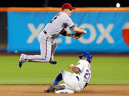 Despite Eric Young's slide, Aaron Hill turns a double play on David Wright's grounder in the first inning.  (USATSI)