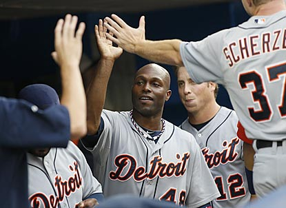 Torii Hunter, who winds up with three RBI, gets congratulated by Tigers teammates after scoring in the third inning.  (USATSI)