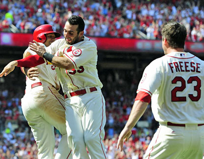Jon Jay (left) celebrates with Daniel Descalso (center) after scoring the winning run on a throwing error. (USATSI)