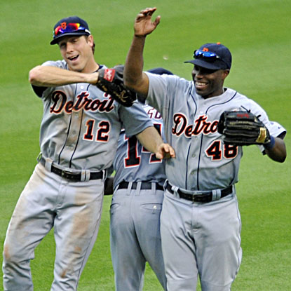 Austin Jackson (left), Andy Dirks and Torii Hunter (right) celebrate the Tigers' 9-4 rout of the second-place Indians. (USATSI)