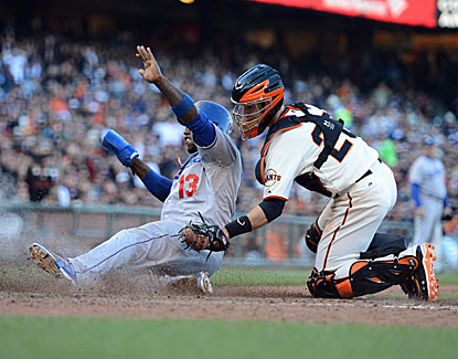 Giants catcher Buster Posey slaps the tag on LA's Hanley Ramirez in San Francisco's 4-2 win over the Dodgers. (USATSI)
