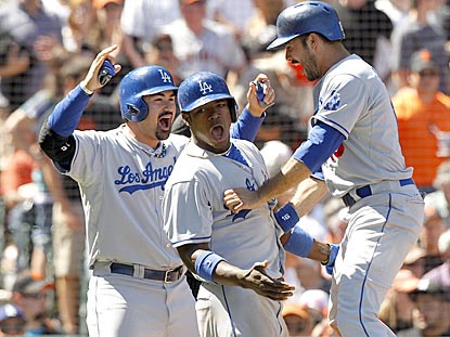 Adrian Gonzalez (left), Yasiel Puig and Andre Ethier exult after scoring the go-ahead runs on AJ Ellis' double in the ninth.  (USATSI)