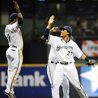 Jean Segura (left) is among the Brewers who want to thank Carlos Gomez (27) for his game-saving catch.  (USATSI)