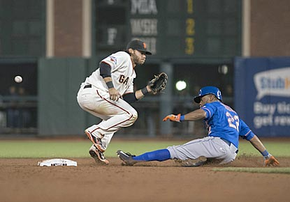 Brandon Crawford fails to handle the throw on Eric Young's stolen base in the 16th inning. Young scores a few batters later.  (USATSI)