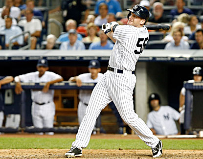 Lyle Overbay watches the ball leave the park for a grand slam against the Royals during the sixth inning. (USATSI)