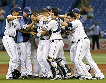 Ben Zobrist (center) is mobbed by teammates after hitting a game-winning RBI single in the 13th inning. (USATSI)