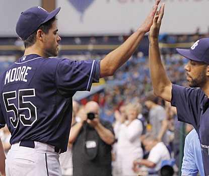 First-time All-Star Matt Moore gets a high-five from David Price after leaving in the eighth inning.  (USATSI)