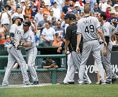 Chris Sale is among the ChiSox taking to the field after Alexei Ramirez (far left) objects to a pitch thrown behind him.  (USATSI)