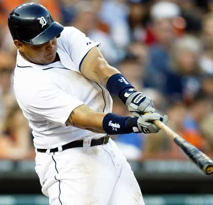Miguel Cabrera hits a sacrifice fly for his 95th RBI in the Tigers' win over the Rangers.  (USATSI)