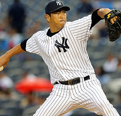 Hiroki Kuroda endures a long rain delay to throw five shutout innings as the Yankees blank the Twins.  (USATSI)