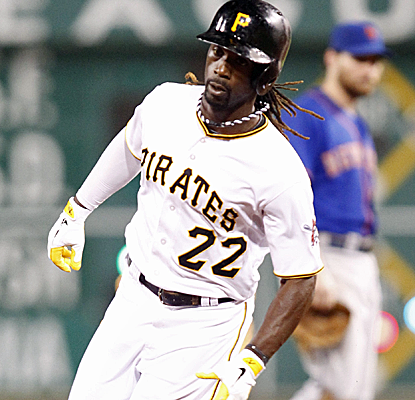 Andrew McCutchen rounds the bases after his game-tying home run helps lift the Pirates to their third straight win.  (USATSI)