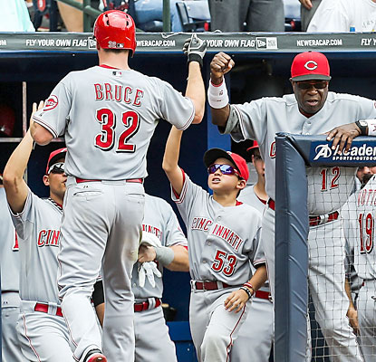 Dusty Baker (right) congratulates Jay Bruce, whose two-run homer helps Cincy jump ahead for good in the third. (USATSI)