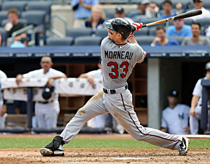 Justin Morneau gets one of his three hits as the Twins win a series at Yankee Stadium for the first time since 2001 (USATSI)