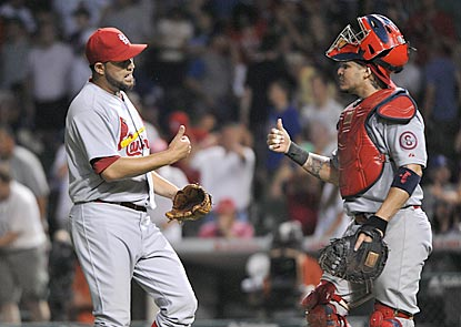 Cardinals closer Edward Mujica and catcher Yadier Molina like how their team's final game before the All-Star break turns out.  (USATSI)