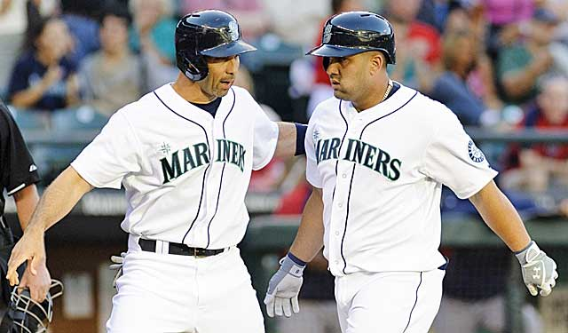 Torrid Raul Ibanez congratulates almost-as-hot Kendrys Morales after a homer. (USATSI)