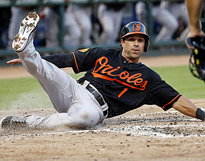 Baltimore's Brian Roberts scores in the third inning, which proves to be the winning run against the Rangers. (USATSI)