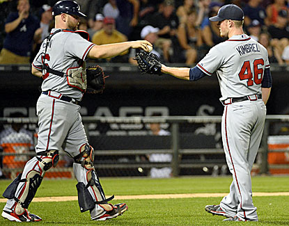 Atlanta closer Craig Kimbrel and catcher Brian McCann celebrate after Kimbrel nails down his 27th save in 29 tries. (USATSI)