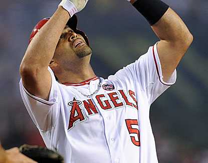 The Angels' Albert Pujols celebrates after slugging his 16th homer with two outs in the third against the A's. (USATSI)