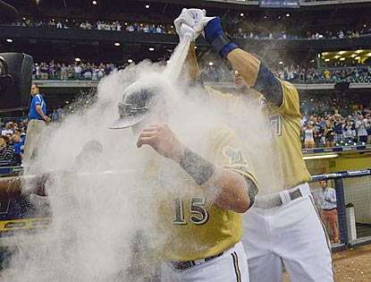 Here's what's next in postgame celebrations. Caleb Gindl (left) takes a powder from Carlos Gomez after his walk-off home run.  (USATSI)