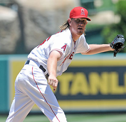 Jered Weaver strikes out nine in eight shutout innings en route to his fifth win of the season. (USATSI)