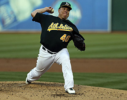 Oakland's Bartolo Colon wins his 14th game for a share of the major league lead. (USATSI)