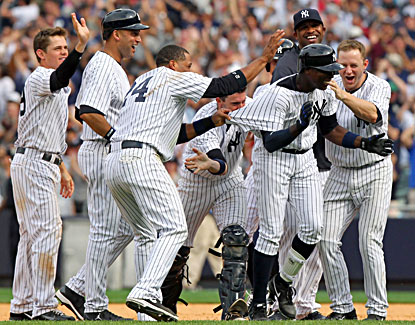 Alfonso Soriano (second from right) is mobbed by teammates after hitting the winning single. (USATSI)