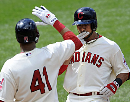 Mike Aviles (right) celebrates his two-run homer with Carlos Santana in the eighth inning. (USATSI)