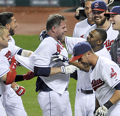 Veteran Jason Giambi is greeted at home plate by the Indians, who move within 2 1/2 games of the Tigers in the AL Central. (USATSI)