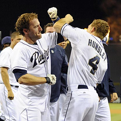 Chris Denorfia (left) celebrates with Nick Hundley after his game-ending home run propels the Padres past the Reds.  (USATSI)