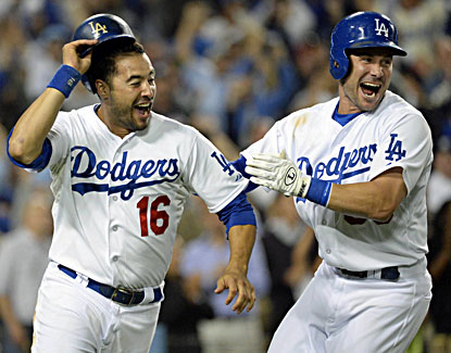 Andre Ethier (left) celebrates with Skip Schumaker after scoring the winning run in the ninth against the Yankees. (USATSI)