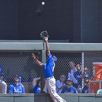 Lorenzo Cain leaps to take a home run away from Trevor Plouffe and get his pitcher out of a tough inning.  (USATSI)