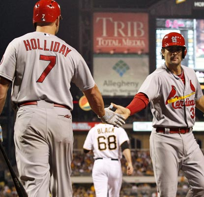 Matt Holliday and Pete Kozma help the Cardinals salvage a win in an otherwise troublesome series against the Pirates.  (USATSI)