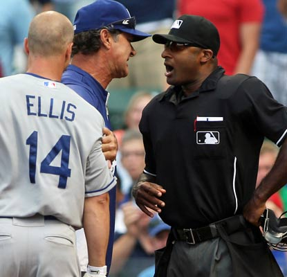 The umps run Mark Ellis and Don Mattingly, but the Dodgers still manage to win their 12th straight road game.  (USATSI)