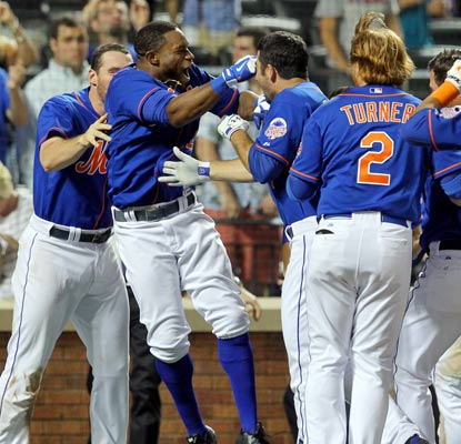 Eric Young Jr. celebrates with his teammates after beating the Royals with the first walk-off hit of his career.  (USATSI)