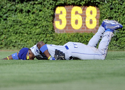 Yasiel Puig makes a diving catch in the sixth, but leaves the game after hurting his hand on the play.  (USATSI)