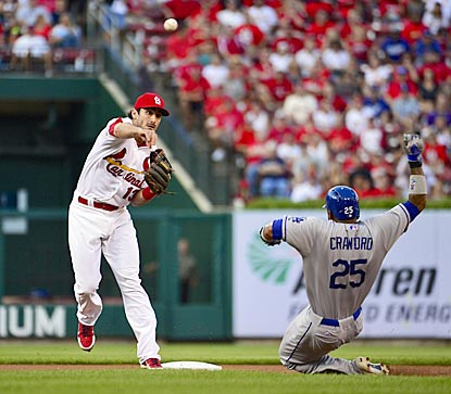 Despite Carl Crawford's slide, Matt Carpenter turns a double play on Mark Ellis' ground ball during the first inning.  (USATSI)