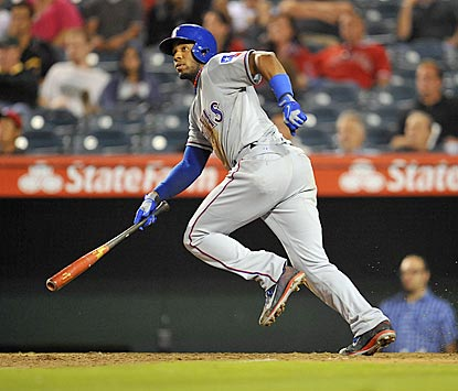 Elvis Andrus completes a 3-for-5 night with an RBI single in the Rangers' four-run ninth inning.  (USATSI)
