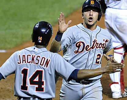 Hernan Perez and Austin Jackson celebrate after scoring on Prince Fielder's double in the 14th inning. (USATSI)