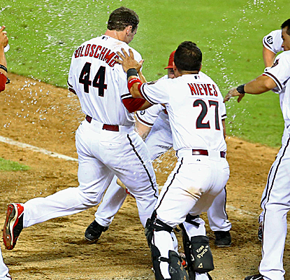 Paul Goldschmidt is mobbed at home plate after connecting for a walk-off home run in the 10th inning.  (USATSI)