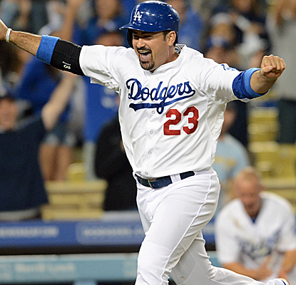 Adrian Gonzalez celebrates as he rounds third base with the winning run to cap an improbable Dodgers comeback.   (USATSI)