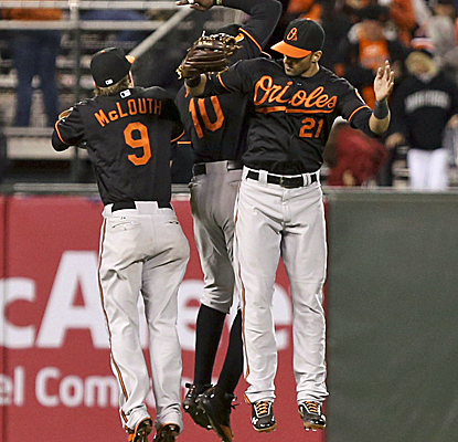 The O's knock off the Giants on a Chris Davis two-run double in the 10th inning following an intentional walk.  (USATSI)