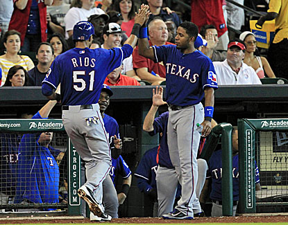 Texas shortstop Elvis Andrus celebrates with Alex Rios, who continues his strong play for his new team, scoring twice. (USATSI)